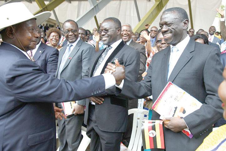 Museveni-greets-Besigye-at-Namugongo