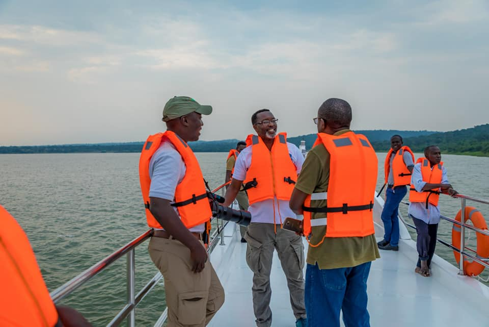 Amos Wekesa and friends on the MV Kazinga
